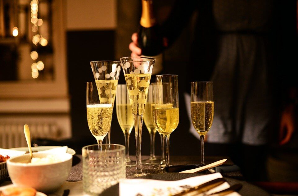 champagne glasses on a table during a party   Fun Birthday Party Ideas for Women in Orlando